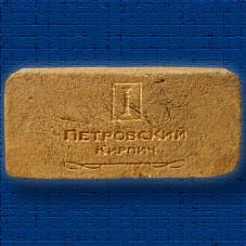 Гравировка логотипа на кирпиче